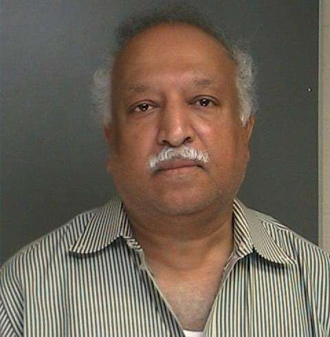 Jacob Mathew, a Port Jefferson neurologist, was arrested