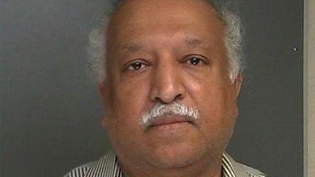 Jacob Mathew, a Port Jefferson neurologist, was arrested