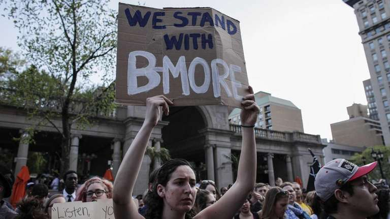 A woman takes part in a Solidarity With