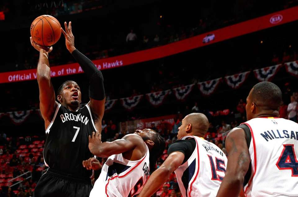 Joe Johnson of the Brooklyn Nets shoots against