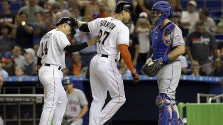 Miami Marlins' Giancarlo Stanton and Martin Prado celebrate