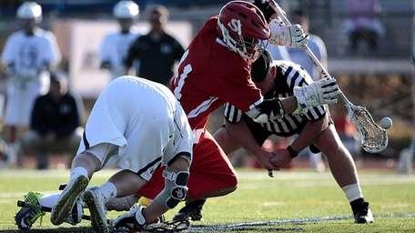 Smithtown East's Gerard Arceri wins the face-off against