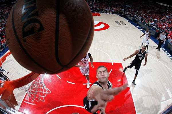 Brook Lopez of the Brooklyn Nets attempts a
