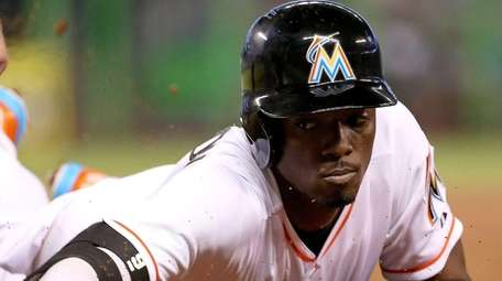 Dee Gordon of the Miami Marlins dives back