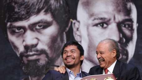 WBO welterweight champion Manny Pacquiao, left, and WBO