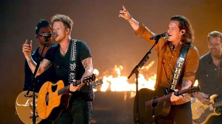 Musicians Brian Kelley, left, and Tyler Hubbard of