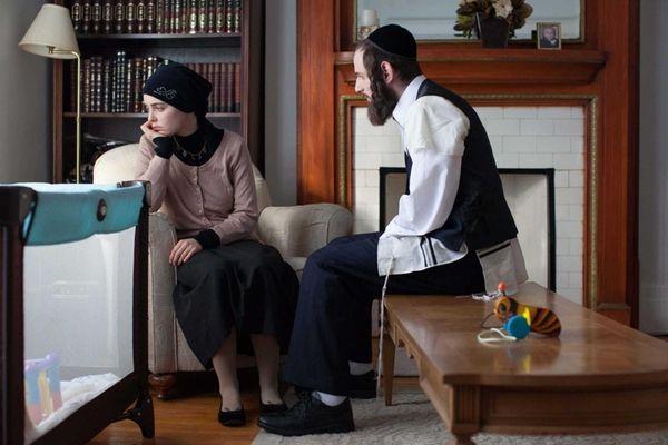 Hadas Yaron as Meira and Luzer Twersky as