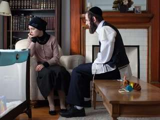 Hadas Yaron as Meira and Luzer Twersky as