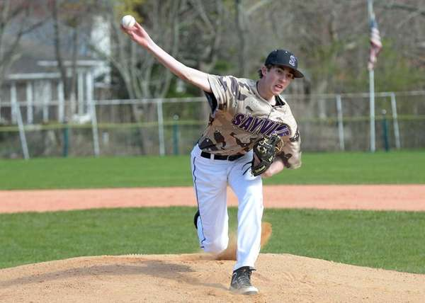 Sayville's Jerry Demeo (26) delivers to the plate