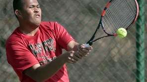 Hills West's Dwayne Davis returns a backhand during