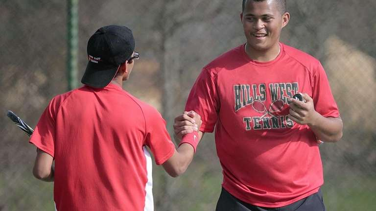 Hills East's Arnav Srivastava, left, and Hills West's