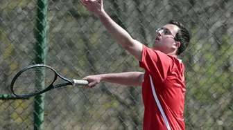 Hills West's Zachary Mollo serves during his first