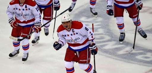 The Washington Capitals' Alex Ovechkin celebrates his first-period