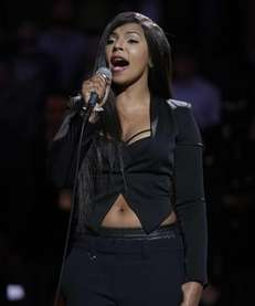 Ashanti sings the national anthem before the Brooklyn