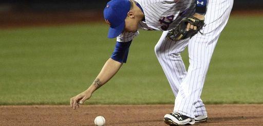New York Mets shortstop Wilmer Flores reacts after