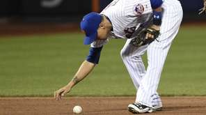 New York Mets shortstop Wilmer Flores reacts after