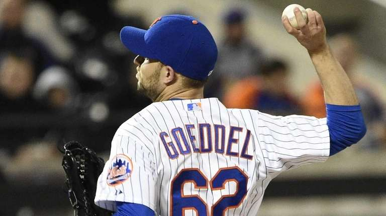 New York Mets relief pitcher Erik Goeddel delivers