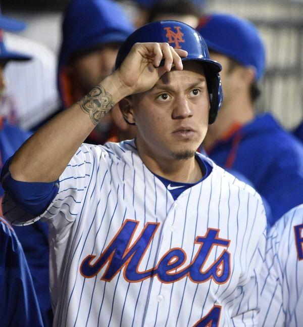 New York Mets shortstop Wilmer Flores looks on