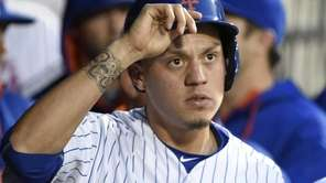 New York Mets shortstop Wilmer Flores looks on