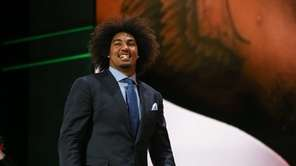 Leonard Williams of the USC Trojans walks on