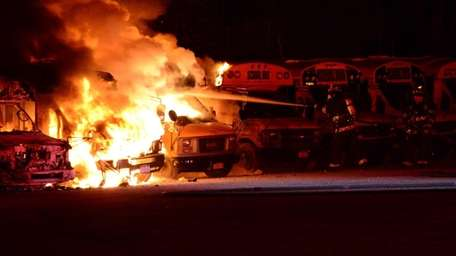 Firefighters battle multiple bus fires at a parking