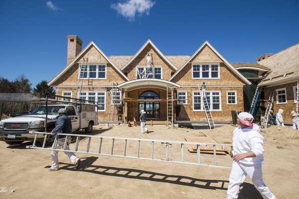 Painters work on an 8,600-square-foot, nearly $20-million home