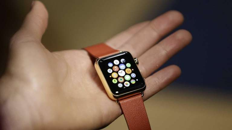 A woman holds the Apple Watch during a