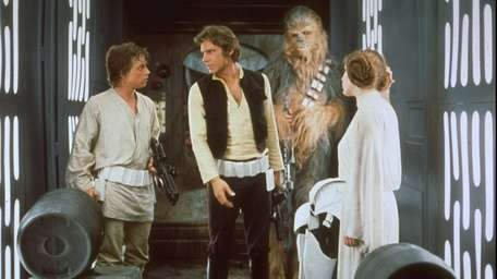 Mark Hamill, Harrison Ford and Carrie Fisher in