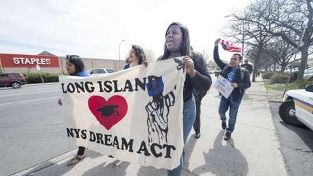 Immigration activists march along Front Street in Hempstead
