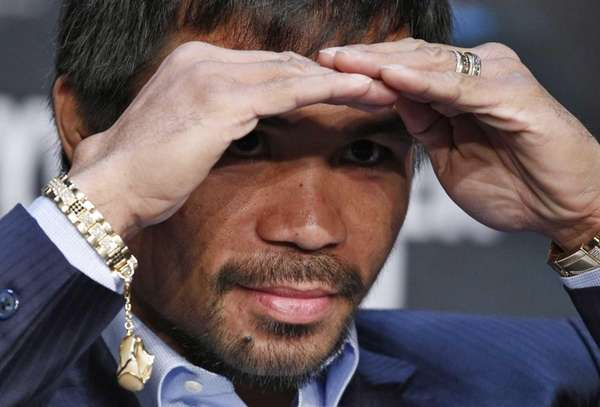 Boxer Manny Pacquiao looks out into the crowd