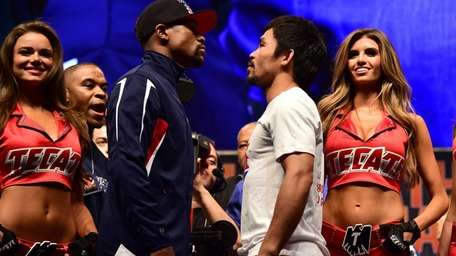 Manny Pacquiao and Floyd Mayweather face off following