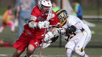 Connetquot's Colin Grippo carries the ball to the