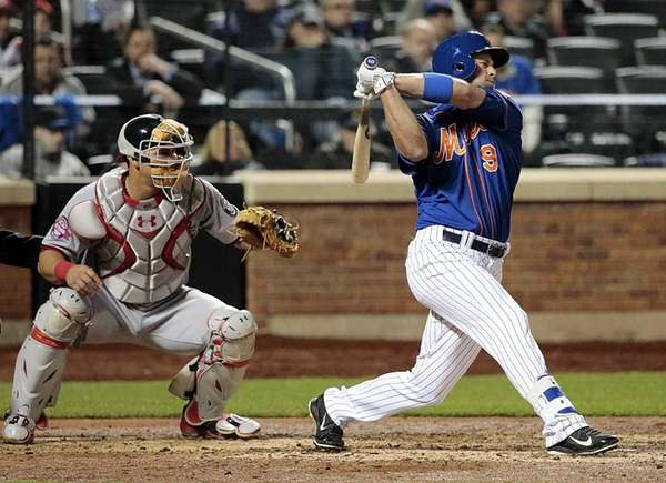 The Mets' Kirk Nieuwenhuis (9) strikes out in