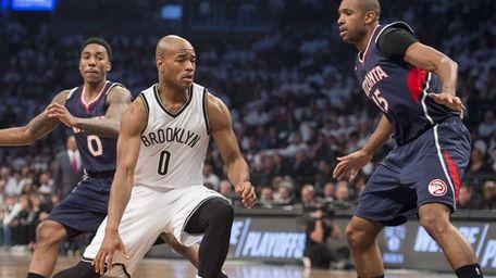 Brooklyn Nets' Jarrett Jack tries to drive past