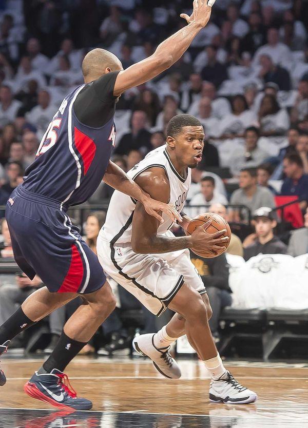 The Nets' Joe Johnson drives against Al Horford