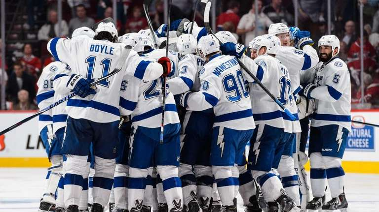 he Tampa Bay Lightning celebrate their overtime victory