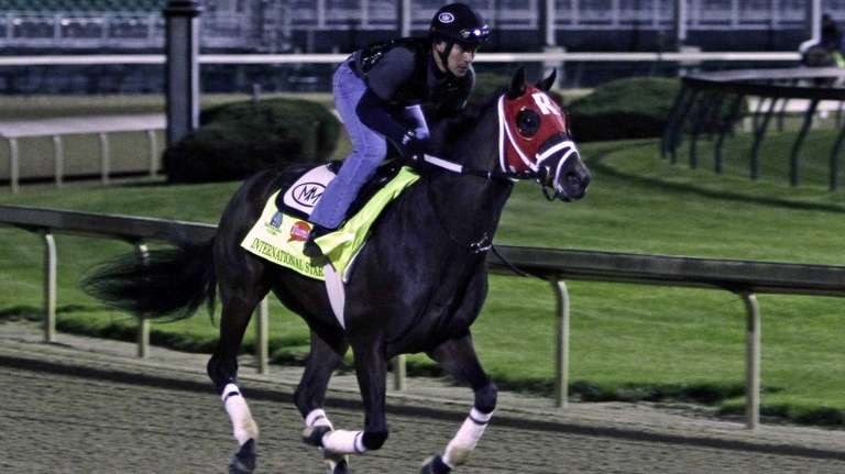 Kentucky Derby entrant International Star, ridden by exercise