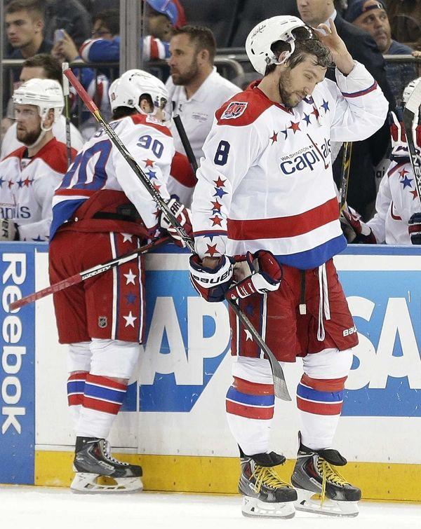 Washington Capitals left wing Alex Ovechki adjusts his