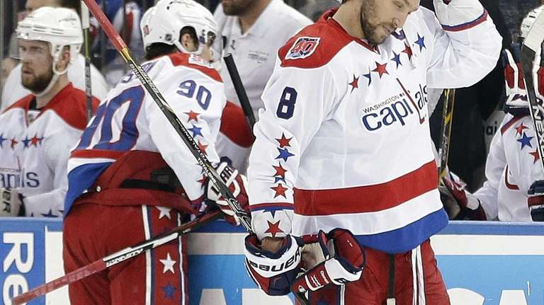 Washington Capitals left wing Alex Ovechki adjusts his