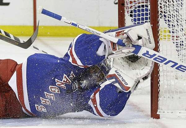 Rangers goalie Henrik Lundqvist makes a diving save