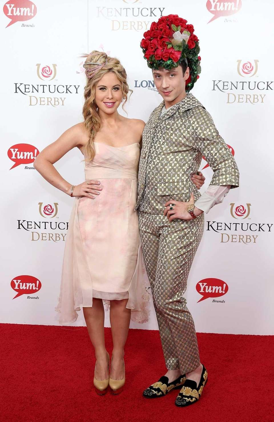 Tara Lipinski (L) and Johnny Weir attend the