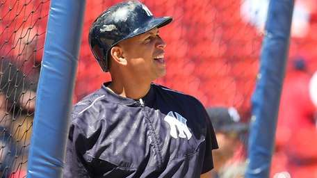 Alex Rodriguez watches the fight of his ball