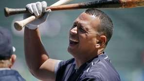 Alex Rodriguez laughs during batting practice before a