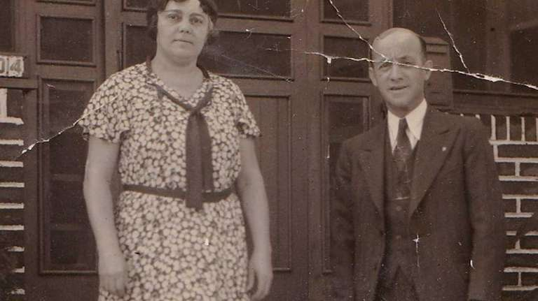 Minnie and Berman Kahn, with their dog, Lindy,
