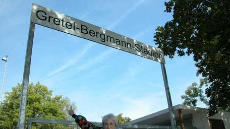 Margaret Lambert points to a sign while visiting