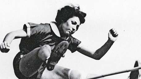 Margaret Lambert, then known as Gretel Bergmann, competes