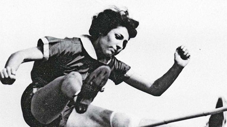 Margaret Lambert, then known as Gretel Bergmann, competes