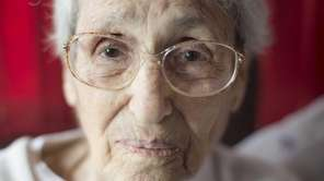 Margaret Lambert, 101, sits in her home in