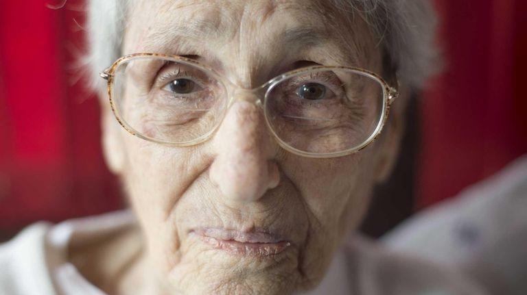 Margaret Lambert, 101, sits in her home in