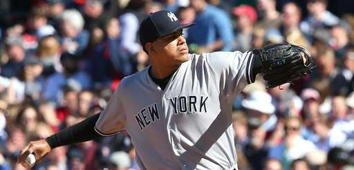 Dellin Betances throws in relief in the ninth